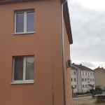Nové okapy bytového domu