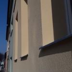 Nová zateplená fasáda bytového domu